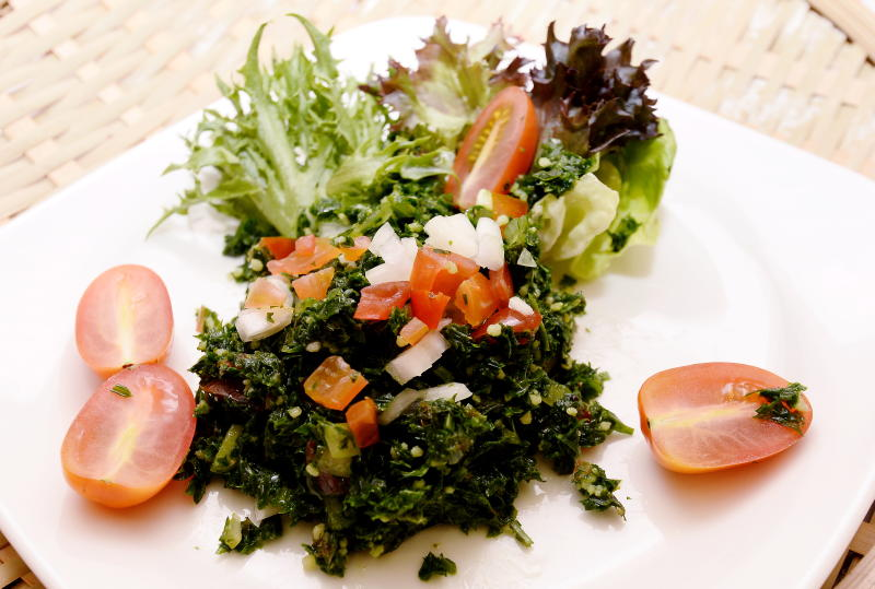 Tabbouleh is a vegetarian dish made from tomatoes, finely chopped parsley, mint, bulgur and onion, and seasoned with olive oil and lemon juice.