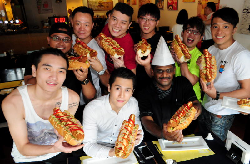 Euro Deli owner Santa Boon (2nd from left) and head chef Gunalan Ramadass with participants of the 12-inch Wiener Speed Eating Contest.