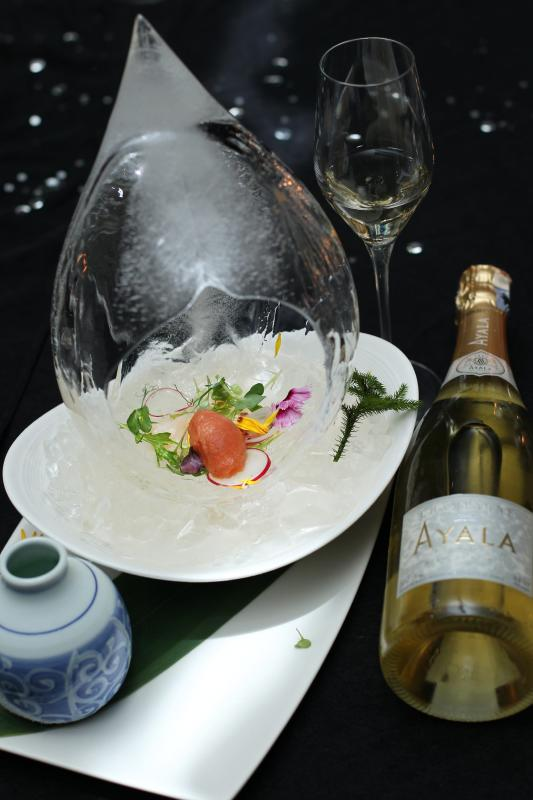 Hokkaido scallops carpaccio with bloody mary sorbet, pickled onion, yuzu dressing and herb salad paired with Ayala Blanc de Blanc 2008.