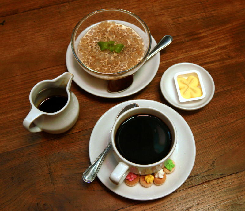 Sago served with santan and gula melaka with the strong black margarine-roasted coffee.