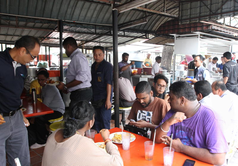 From corporate heads to despatch boys, Anuar's Fish Head Curry stall draws in a variety of customers.
