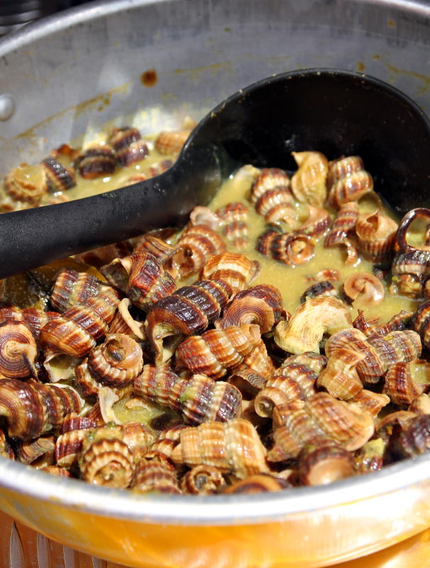 If you're feeling adventurous, try the siput sedut masak lemak.