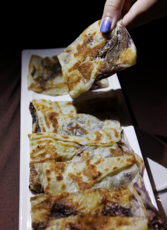 Instead of using crepes or pancakes, their dessert called ChocNaNai, uses roti canai and is filled with chocolate and banana.