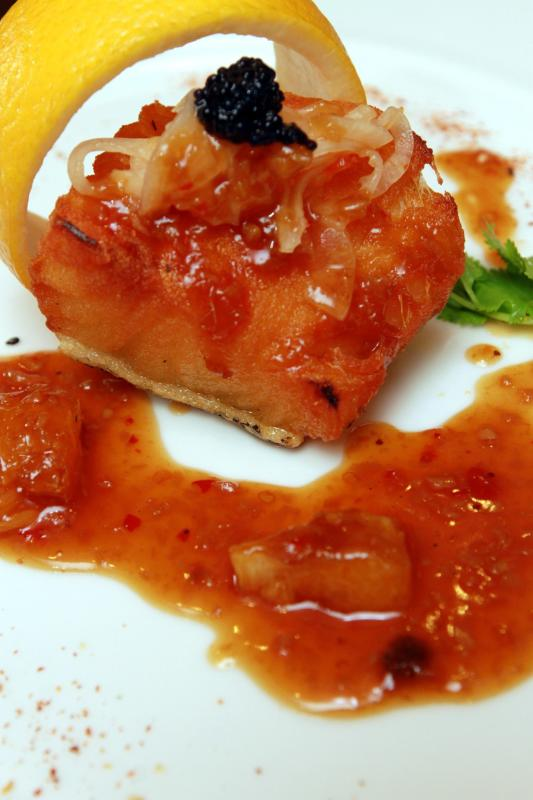 The Pan-Fried Marinated Cod Fish with Spicy Mandarin Orange Sauce and Thai-Style Onions is a delicious main.