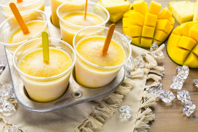 42021745 - homemade low calorie icepops made with mango, pineapple and coconut milk.