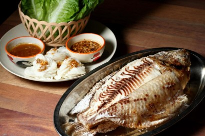 BBQ Tilapia served with Thai Herbs and Vegetables.