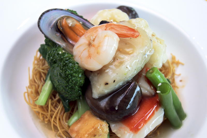 Seafood lovers should try the delicious Cantonese Seafood Noodles.