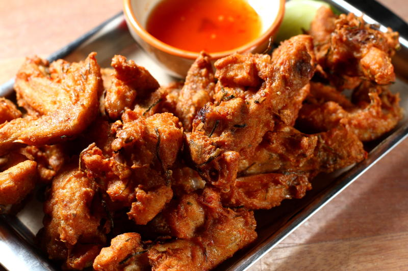 Served hot and crunchy, the Thai Fried Chicken Wings is a perfect dish to share with friends.