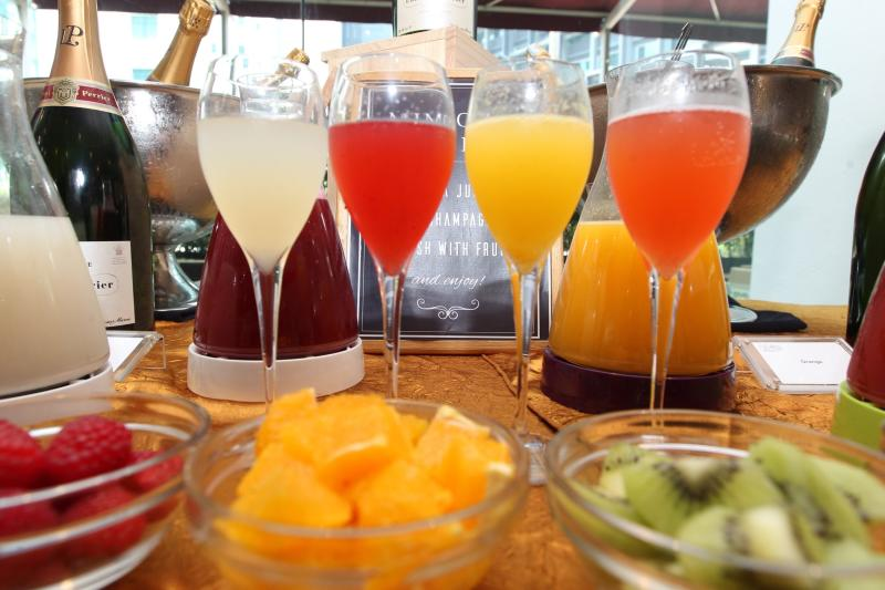 The Make-Your-Own-Mimosa bar allows guests to pick juices that are then mixed with Laurent-Perrier Brut champagne.