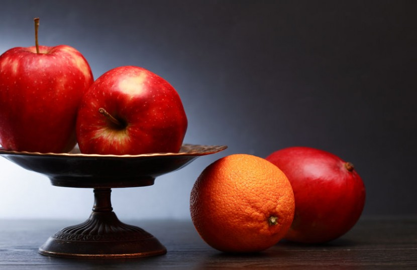 Apples on pedestal fruit bowl