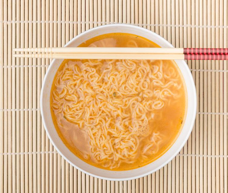50924793 - instant noodles on wood background