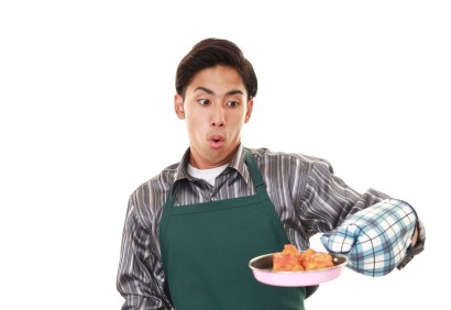 42386474 - surprised man wearing kitchen apron