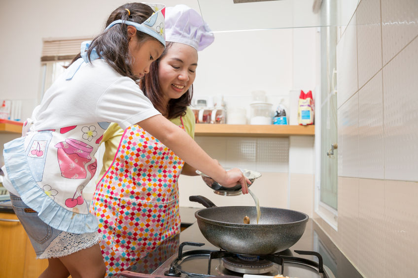 60301896 - asian family enjoy making pancake, asian mother and daughter enjoy making bakery cake, little asian girl and mom enjoy decorate cake in real life kitchen,asian mom teaching daughter to learn making pancake in real life kitchen at home