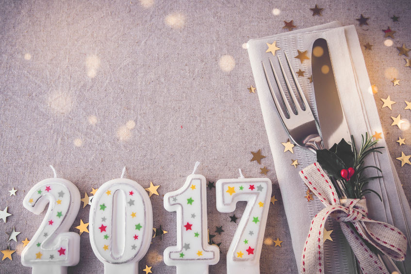 60423415 - happy new year 2017 table place setting, holidays copy space fairy light toning background