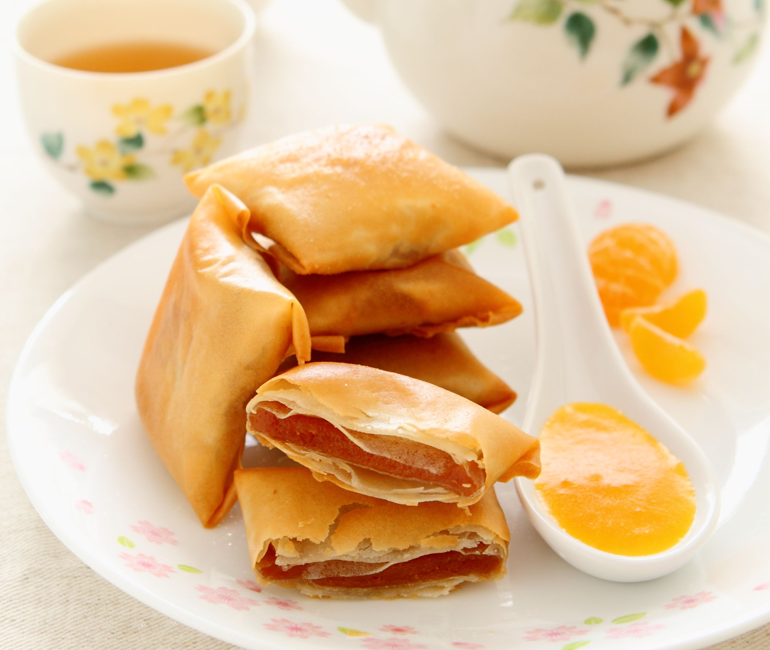 Kum Jiong Nin Koh (Deep-fried Glutinous Rice Cake Parcels with Mandarin Orange Coulis)