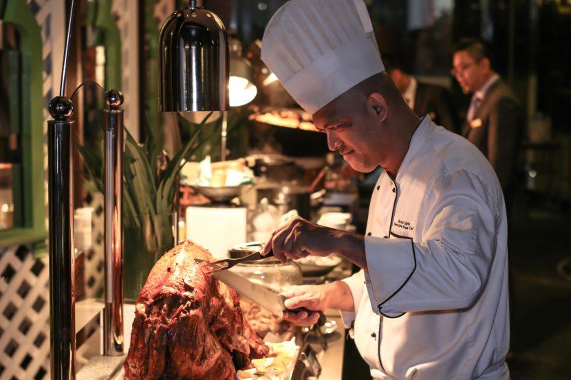 Executive Sous Chef Razali Idris Carving an Oven Roasted Whole Lamb - Grand Millenium KL