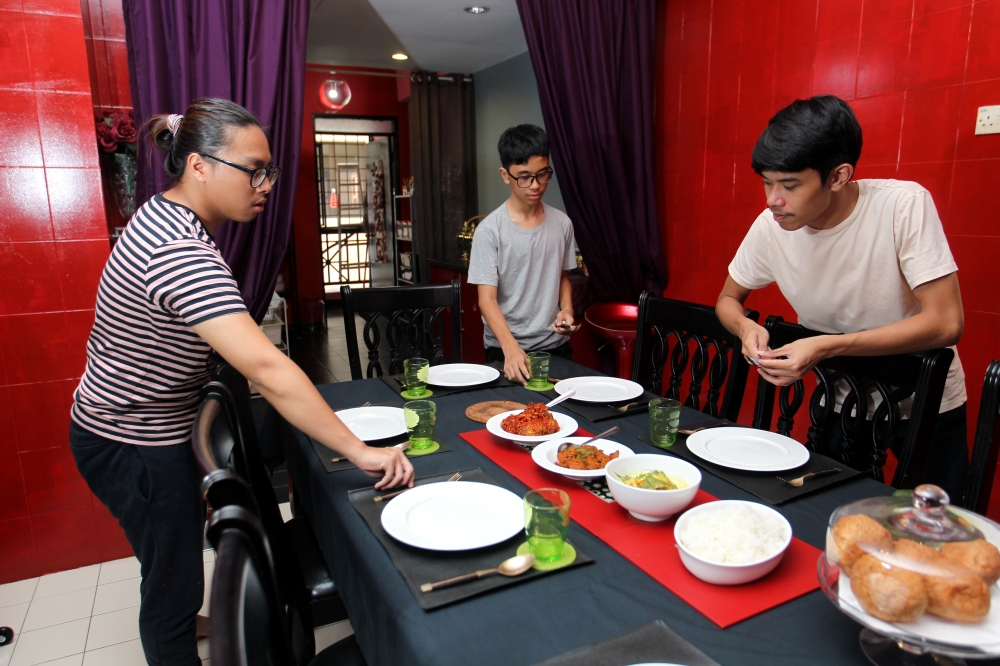 Razif has trained his three boys to make all sorts of Malay heritage food and the brothers now often work together to create these meals. - ART CHEN/The Star