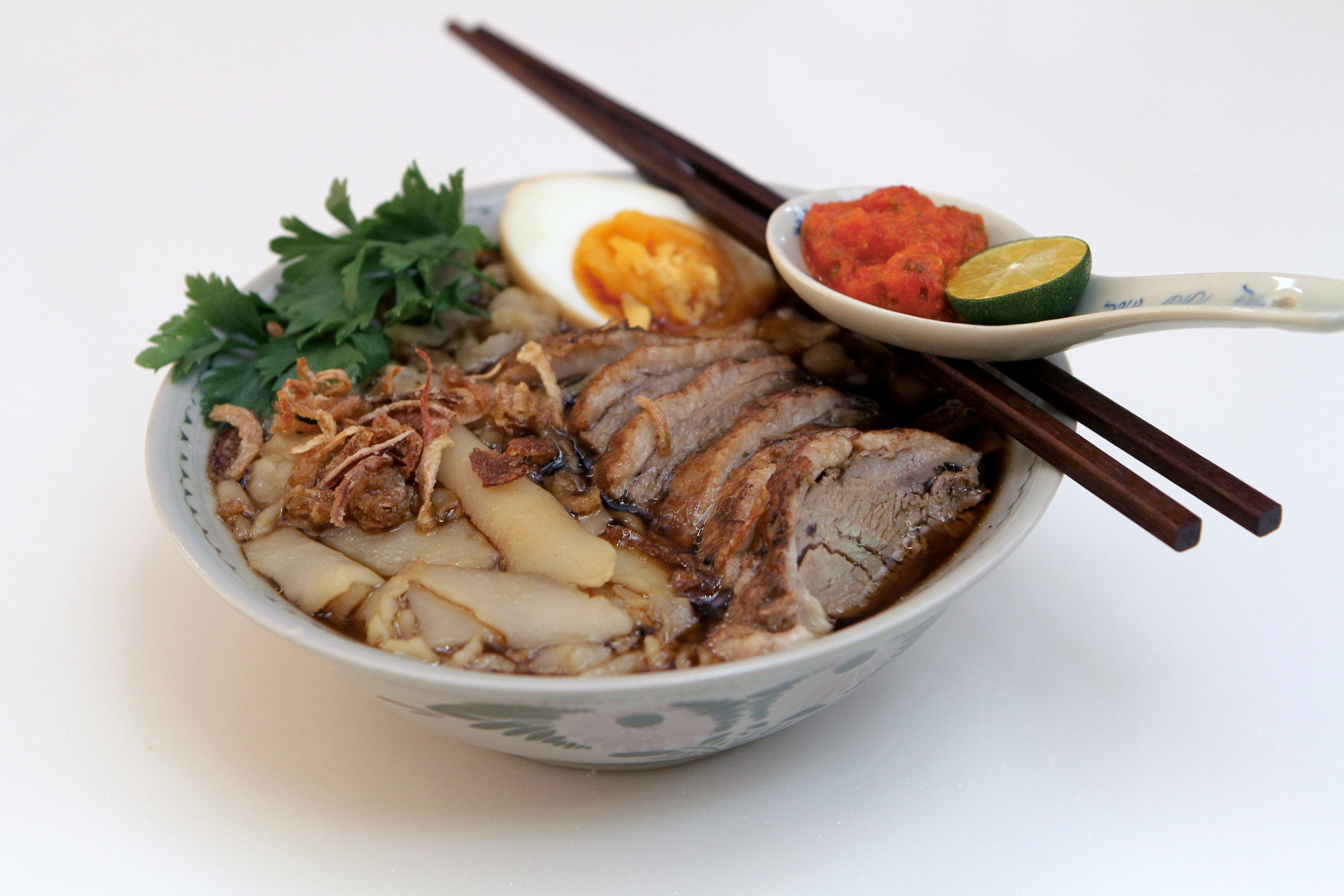 Braised duck with curl noodles
